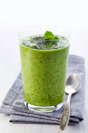 Glass of healthy green vegetable and fruit smoothie Stock Photo
