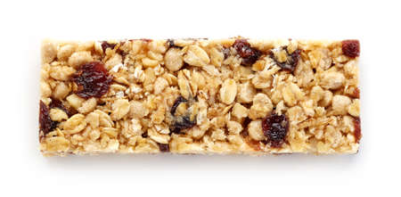 oats: Granola bar with raisins isolated on white background