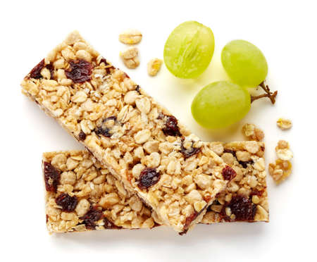 a seed: Granola bar with raisins and grapes isolated on white background