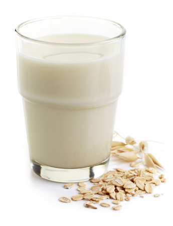 Glass of oat milk isolated on white background Imagens
