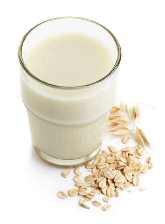 Glass of oat milk isolated on white background Stock Photo