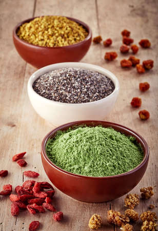 superfood: Bowls of various superfood on wooden background Stock Photo