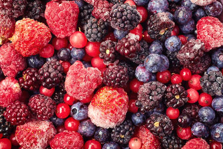 Close up of frozen mixed fruit - berries - red currant, raspberry, strawberry, blackberry, blueberry