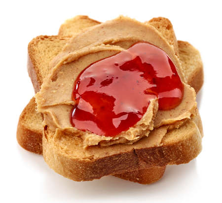 jelly sandwich: Peanut butter and strawberry jelly sandwich isolated on white background