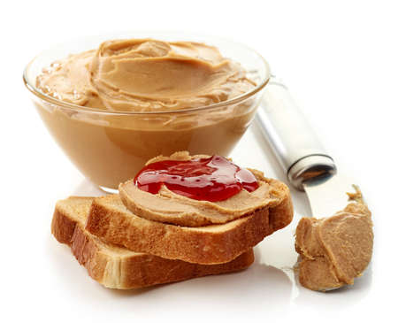jelly sandwich: Peanut butter and strawberry jelly sandwich, bowl of peanut butter and a knife isolated on white background