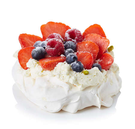 Pavlova meringue cake with cream and berries isolated on white background