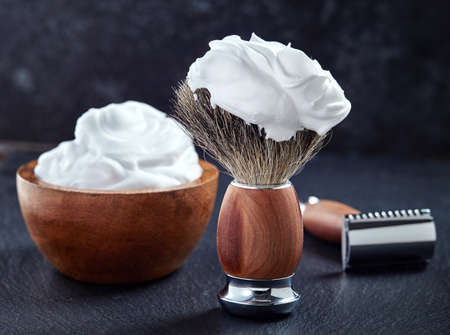 Wooden shaving accessories on black background