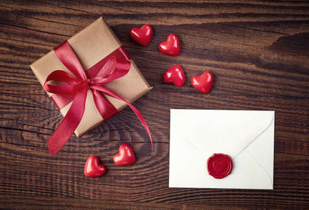 text box design: Gift box and love letter on wooden background from top view Stock Photo