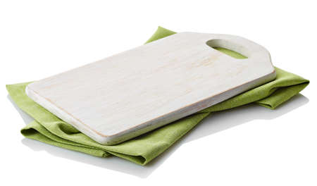 White wooden cutting board on cotton napkin isolated on white background. Clipping path Stock Photo