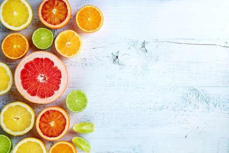 citrus: Various colorful citrus fruits on white wooden background, Top view