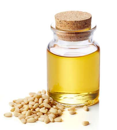 pine nut: Bottle of pine nut oil and pine nuts isolated on white background