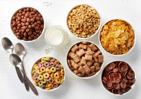 loop: Bowls of various cereals and milk from top view