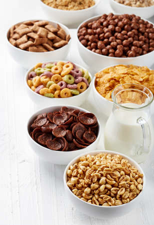 Bowls of various cereals and milk