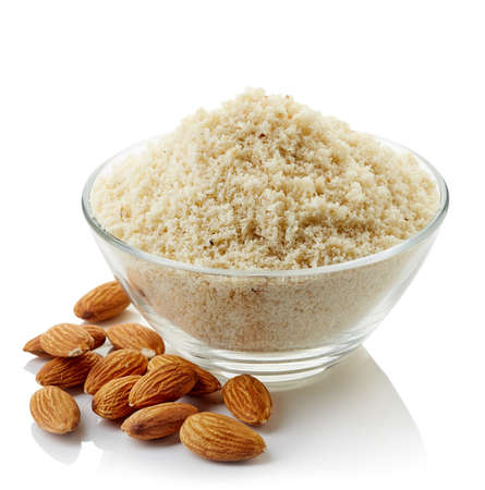Bowl of almond flour isolated on white background