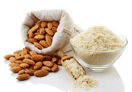 Almond flour and almonds isolated on white background
