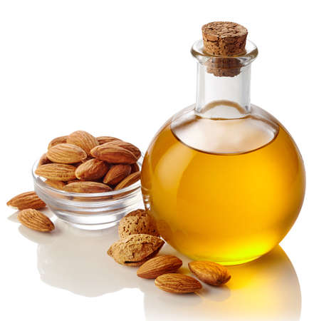 Bottle of almond oil isolated on white background Stock Photo
