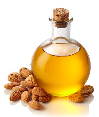 Bottle of almond oil isolated on white background Фото со стока