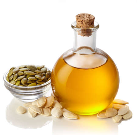 Bottle of pumpkin seed oil isolated on white background