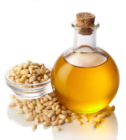 pine nut: Bottle of pine nut oil isolated on white background