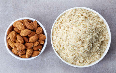 almond: Bowl of almond flour and bowl of almonds from top view