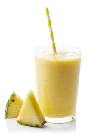 Glass of fresh healthy pineapple smoothie isolated on white background