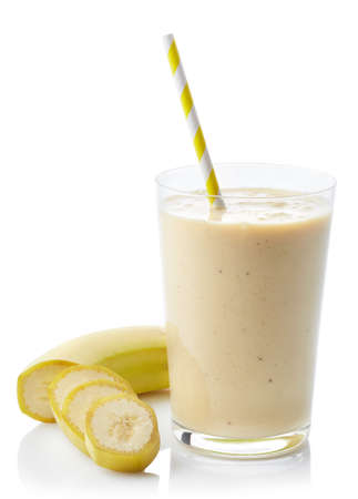 Glass of fresh healthy banana smoothie isolated on white background