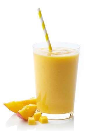 Glass of fresh healthy mango smoothie isolated on white background
