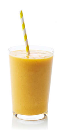 Glass of fresh healthy peach smoothie isolated on white background 写真素材