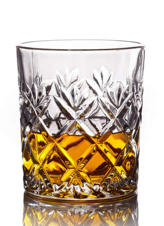 crystal glass: Glass of whiskey isolated on white background Stock Photo