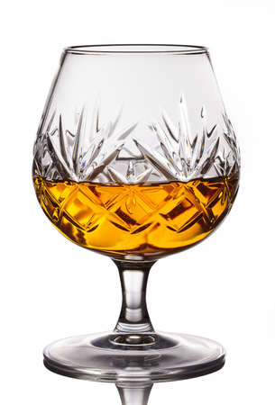 cognac: Glass of cognac isolated on white background