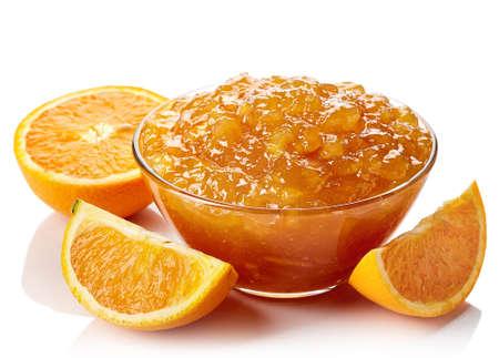 Bowl of orange jam isolated on white background