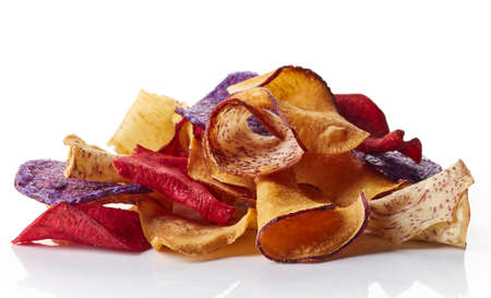 Heap of healthy colorful vegetable chips isolated on white background Stock Photo