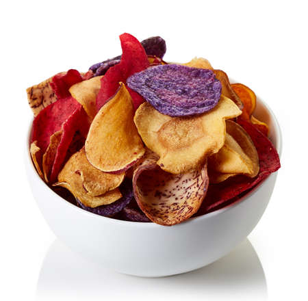 Bowl of healthy colorful vegetable chips isolated on white background