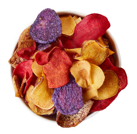 Bowl of healthy colorful vegetable chips isolated on white background from top view Reklamní fotografie - 63450929