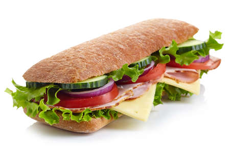 filled: Fresh submarine sandwich with ham, cheese, tomatoes, cucumbers, lettuce and onions isolated on white background Stock Photo