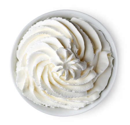 Bowl of whipped cream isolated on white background from top view