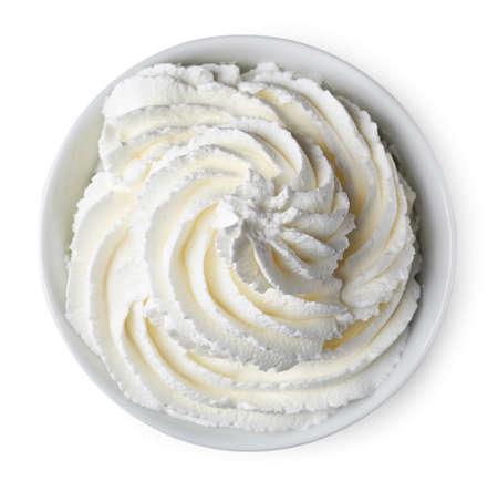 Bowl van slagroom op een witte achtergrond van hoogste mening Stockfoto