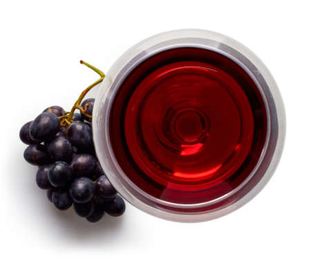 Glass of red wine and grapes isolated on white background from top view Stockfoto