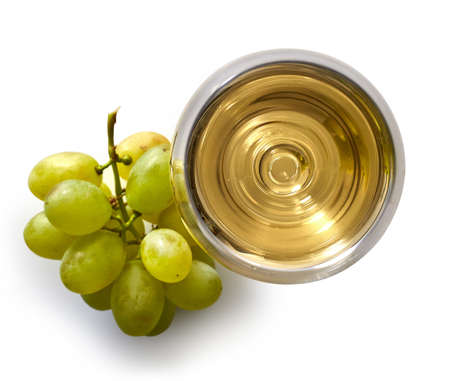 Glass of white wine and grapes isolated on white background from top view
