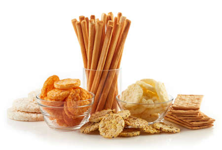 Gluten free food. Various snacks (bread sticks, crackers and rice cakes) isolated on white background Stock Photo