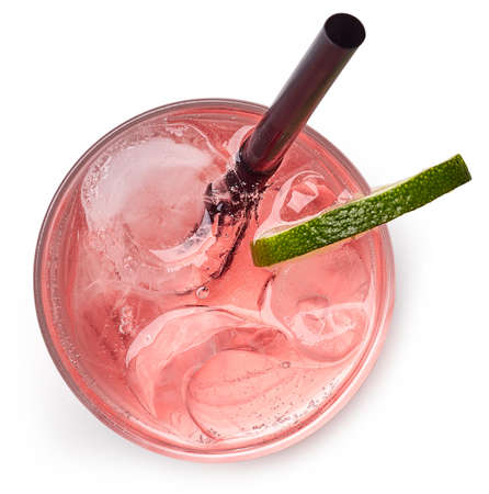 Glass of pink soda drink with ice isolated on white background. From top view 免版税图像