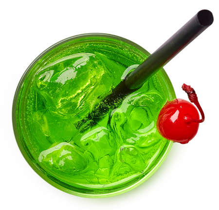 Glass of green cocktail isolated on white background from top view 免版税图像