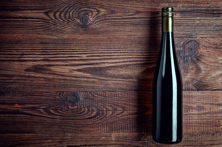 Bottle of white wine on wooden background from top view Stock Photo