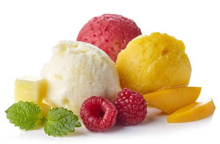 Pineapple, raspberry and mango ice cream sorbet balls isolated on white background