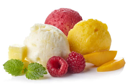 Pineapple, raspberry and mango ice cream sorbet balls isolated on white background