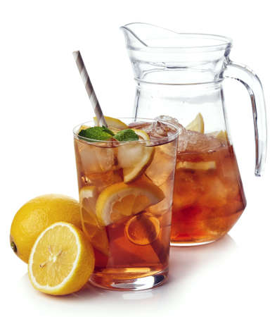 Pitcher with glass of lemon ice tea isolated on white background
