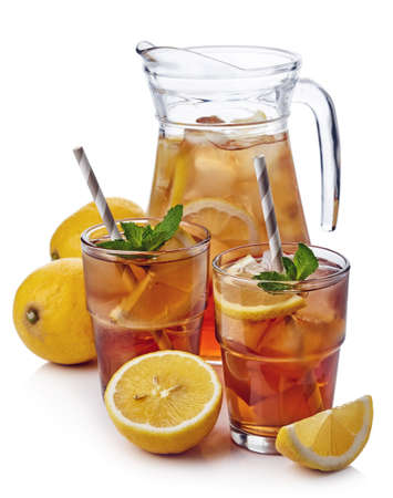 Pitcher with two glasses of lemon ice tea isolated on white background Zdjęcie Seryjne