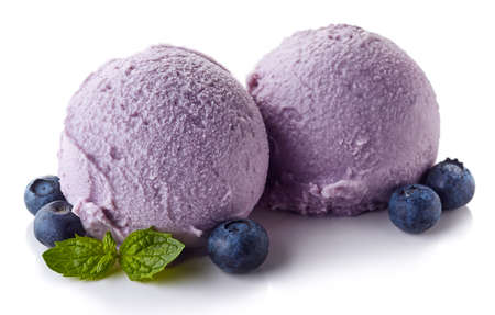Two purple blueberry ice cream balls isolated on white background