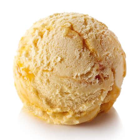 One yellow mango ice cream ball isolated on white background