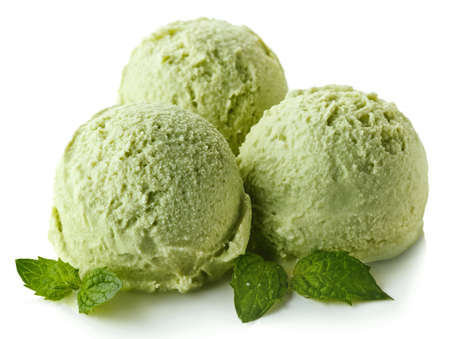 Three green apple mint ice cream balls isolated on white background